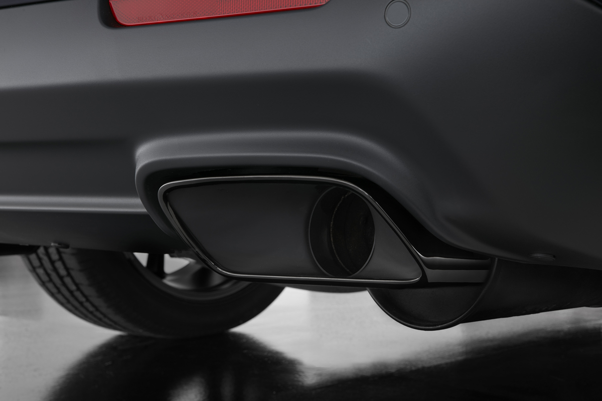 Standard chrome exhaust tips are replaced with Dodge Challenger