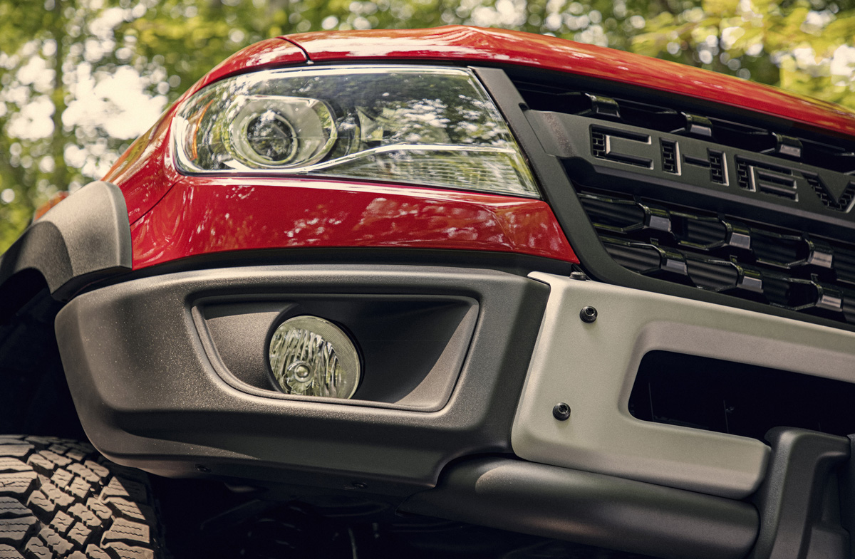 AEV-designed stamped steel front bumpers feature fog lights and
