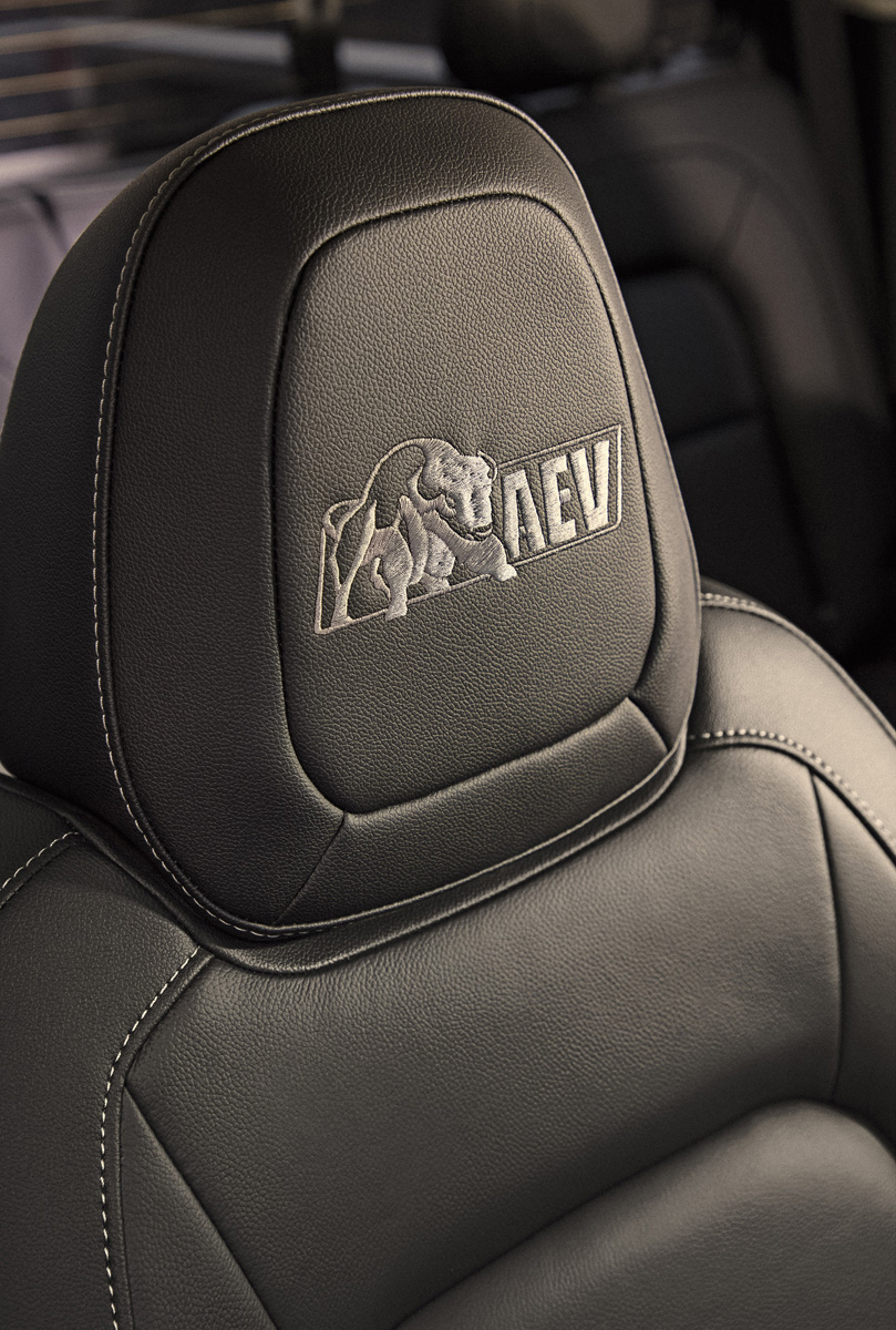 "Bison features embroidered ""AEV"" logos on the floor liners a"